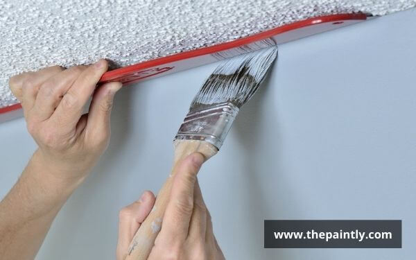 How to paint edges between wall and ceiling